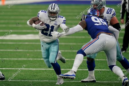 Dallas Cowboys' Ezekiel Elliott runs the ball during the first half of an NFL football game against the New York Giants, in East Rutherford, N.J