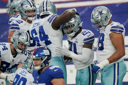 Dallas Cowboys' Ezekiel Elliott, second from right, celebrates his touchdown during the second half of an NFL football game against the New York Giants, in East Rutherford, N.J