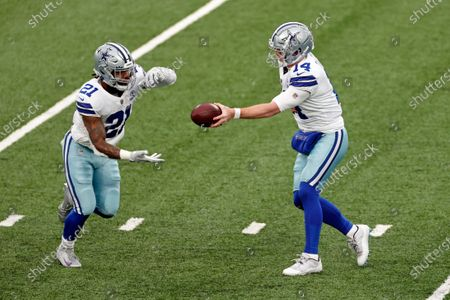 Stock Image of Dallas Cowboys quarterback Andy Dalton (14) hands the ball off to running back Ezekiel Elliott (21) during an NFL football game against the New York Giants, in East Rutherford, N.J
