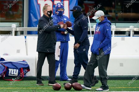 New York Giants owner John Mara, left, greets people before an NFL football game between the New York Giants and the Dallas Cowboys, in East Rutherford, N.J