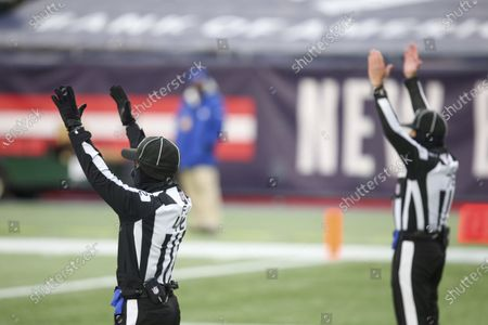Stock Photo of Field judge Nathan Jones (42) and back judge Greg Meyer (78) signal a good extra point during an NFL football game between the New England Patriots and the New York Jets, in Foxborough, Mass