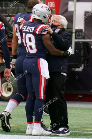 New England Patriots special teams captain Matthew Slater, left, greets team owner Robert Kraft before an NFL football game against the New York Jets, in Foxborough, Mass
