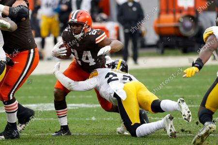 Cleveland Browns running back Nick Chubb (24) is tackled by Pittsburgh Steelers linebacker Marcus Allen (27) during an NFL football game, in Cleveland. Cleveland defeated Pittsburgh 24-22