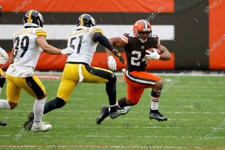Cleveland Browns running back Nick Chubb (24) runs the ball past Pittsburgh Steelers linebacker Avery Williamson (51) during an NFL football game, in Cleveland. Cleveland defeated Pittsburgh 24-22