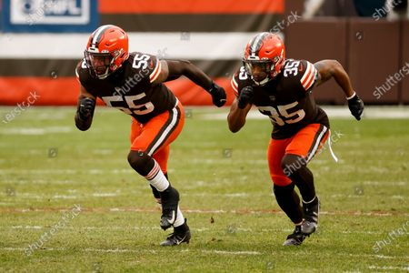 Stock Image of Cleveland Browns linebacker Tae Davis (55) and safety Jovante Moffatt (35) run off of the line of scrimmage during an NFL football game against the Pittsburgh Steelers, in Cleveland