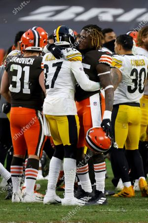 Stock Image of Pittsburgh Steelers linebacker Marcus Allen (27) hugs Cleveland Browns tight end David Njoku (85) after an NFL football game, in Cleveland. Cleveland defeated Pittsburgh 24-22
