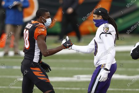 Stock Image of Cincinnati Bengals wide receiver A.J. Green (18), left greets Baltimore Ravens wide receiver Chris Moore (10) before an NFL football game, in Cincinnati