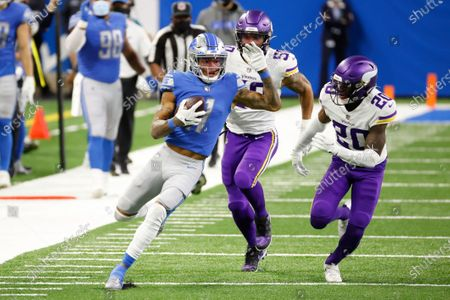 Detroit Lions wide receiver Marvin Jones (11) runs the ball chased by Minnesota Vikings outside linebacker Eric Wilson (50) and cornerback Jeff Gladney (20) in the first half during an NFL football game, in Detroit