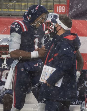 New England Patriots quarterback Cam Newton (L) embraces New England Patriots offensive coordinator Josh McDaniels (R) following the New England Patriots win over the New York Jets to end the regular season at Gillette Stadium in Foxborough, Massachusetts, USA, 03 January 2021.
