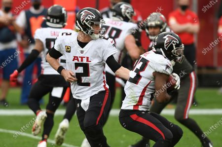 Atlanta Falcons quarterback Matt Ryan (2) hands off to running back Brian Hill during the second half of an NFL football game against the Tampa Bay Buccaneers, in Tampa, Fla