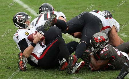 Atlanta Falcons quarterback Matt Ryan (2) gets sacked by Tampa Bay Buccaneers linebacker Cam Gill (49) during the second half of an NFL football game, in Tampa, Fla