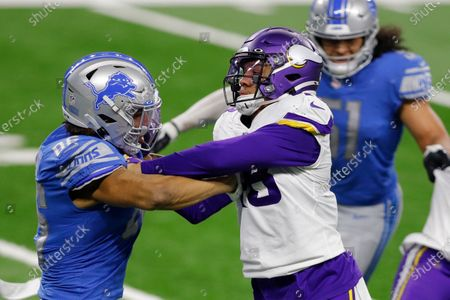 Detroit Lions tight end Hunter Bryant, left, and tight end Jesse James (83) tackle Minnesota Vikings linebacker Blake Lynch (48) during the second half of an NFL football game, in Detroit