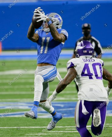 Stock Picture of Detroit Lions wide receiver Marvin Jones (11) makes a catch as Minnesota Vikings inside linebacker Todd Davis (40) defends during the second half of an NFL football game, in Detroit