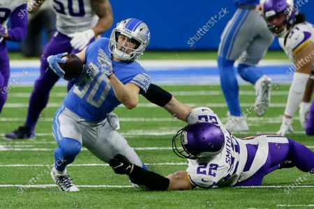 Detroit Lions wide receiver Danny Amendola (80) is brought down by Minnesota Vikings strong safety Harrison Smith (22) during the second half of an NFL football game, in Detroit