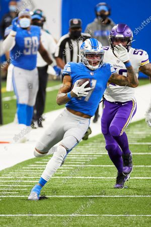 Detroit Lions wide receiver Marvin Jones (11) runs the ball against the Minnesota Vikings during an NFL football game, in Detroit