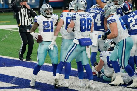 Dallas Cowboys' Ezekiel Elliott, left, celebrates his touchdown during the second half of an NFL football game against the New York Giants, in East Rutherford, N.J
