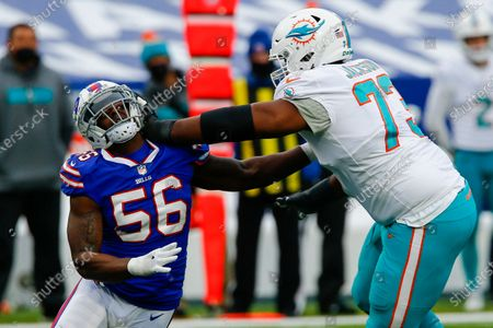 Buffalo Bills defensive end Mike Love (56) is blocked by Miami Dolphins offensive tackle Austin Jackson (73) in the first half of an NFL football game, in Orchard Park, N.Y
