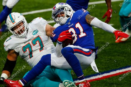 Buffalo Bills strong safety Dean Marlowe (31) is tackled on the run by Miami Dolphins defensive tackle Ray Smith (77) in the second half of an NFL football game, in Orchard Park, N.Y