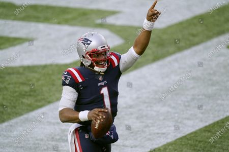 New England Patriots quarterback Cam Newton celebrates his touchdown catch of a pass thrown by wide receiver Jakobi Meyers during the second half of an NFL football game against the New York Jets, in Foxborough, Mass