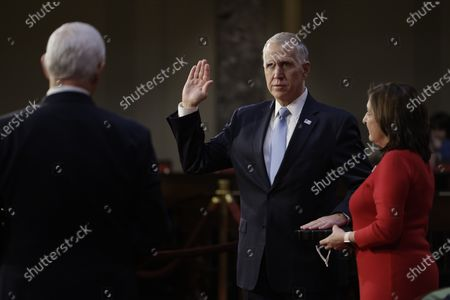 United States Senator Thom Tillis (Republican of North Carolina), center, is ceremoniously sworn-in by U.S. Vice President Mike Pence, at the U.S. Capitol in Washington, D.C., U.S.,. The 117th Congress begins today with the election of the speaker of the House and administration of the oath of office for lawmakers in both chambers, procedures that will be modified to account for Covid-19 precautions. Photographer: Samuel Corum/Bloomberg