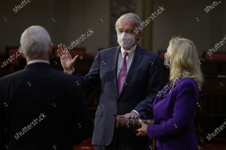 United States Senator Ed Markey (Democrat of Massachusetts), center, wears a protective mask while being ceremoniously sworn-in by U.S. Vice President Mike Pence, left, with wife Susan Blumenthal, right, at the U.S. Capitol in Washington, D.C., U.S.,. The 117th Congress begins today with the election of the speaker of the House and administration of the oath of office for lawmakers in both chambers, procedures that will be modified to account for Covid-19 precautions. Photographer: Samuel Corum/Bloomberg