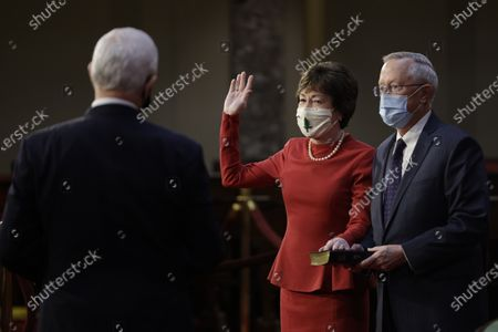United States Senator Susan Collins (Republican of Maine), center, wears a protective mask while being ceremoniously sworn-in by U.S. Vice President Mike Pence, left, with husband Thomas Daffron, right, at the U.S. Capitol in Washington, D.C., U.S.,. The 117th Congress begins today with the election of the speaker of the House and administration of the oath of office for lawmakers in both chambers, procedures that will be modified to account for Covid-19 precautions. Photographer: Samuel Corum/Bloomberg