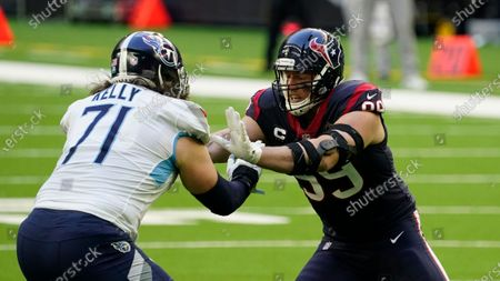 Houston Texans defensive end J.J. Watt (99) is blocked by Tennessee Titans offensive tackle Dennis Kelly (71) during the first half of an NFL football game, in Houston