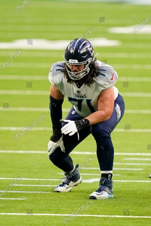 Tennessee Titans offensive lineman Dennis Kelly (71) lines up for the snap during an NFL football game against the Houston Texans, in Houston