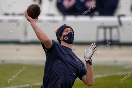 Chicago Bears' Nick Foles warms up before an NFL football game against the Green Bay Packers, in Chicago