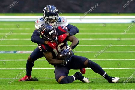 Houston Texans wide receiver Keke Coutee (16) is tackled by Tennessee Titans cornerback Malcolm Butler (21) during the first half of an NFL football game, in Houston