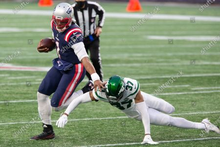 New England Patriots quarterback Cam Newton (1) dodges a tackle by New York Jets cornerback Bryce Hall (37) on a keeper in the third quarter at Gillette Stadium in Foxborough, Massachusetts on Sunday, January 3, 2021. The Patriots defeated the Jets 28-14.