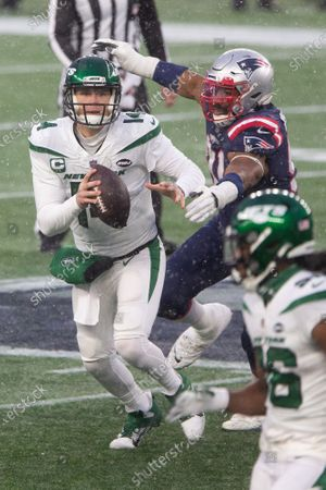 Stock Picture of New York Jets quarterback Sam Darnold (14) is pressured by New England Patriots defensive lineman Carl Davis (98) on a pass in the fourth quarter at Gillette Stadium in Foxborough, Massachusetts on Sunday, January 3, 2021. The Patriots defeated the Jets 28-14.