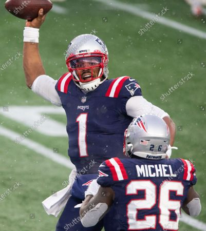 New England Patriots quarterback Cam Newton (1) celebrates with Sony Michel (26) after the two connected on a 31-yard touchdown in the fourth quarter against the New York Jets at Gillette Stadium in Foxborough, Massachusetts on Sunday, January 3, 2021. The Patriots defeated the Jets 28-14.
