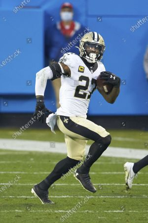 New Orleans Saints safety Malcolm Jenkins (27) returns an interception during an NFL football game against the Carolina Panthers, in Charlotte, N.C