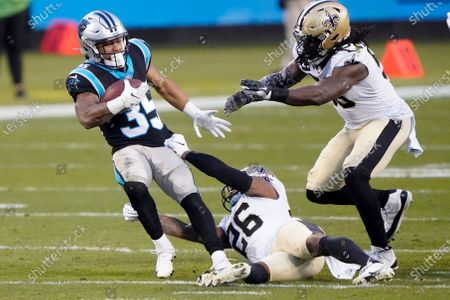 Carolina Panthers running back Rodney Smith is tackled by New Orleans Saints cornerback P.J. Williams during the first half of an NFL football game, in Charlotte, N.C