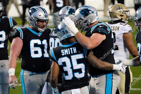 Carolina Panthers running back Rodney Smith celebrates after scoring against the New Orleans Saints during the first half of an NFL football game, in Charlotte, N.C