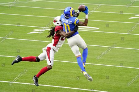Los Angeles Rams wide receiver Josh Reynolds (11) catches a pass against Arizona Cardinals cornerback Dre Kirkpatrick (20) during the first half of an NFL football game in Inglewood, Calif