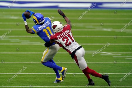 Los Angeles Rams wide receiver Josh Reynolds (11) makes a catch in front of Arizona Cardinals cornerback Patrick Peterson (21) during the first half of an NFL football game, in Inglewood, Calif
