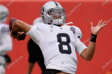 Las Vegas Raiders quarterback Marcus Mariota (8) warms up before an NFL football game against the Denver Broncos, in Denver