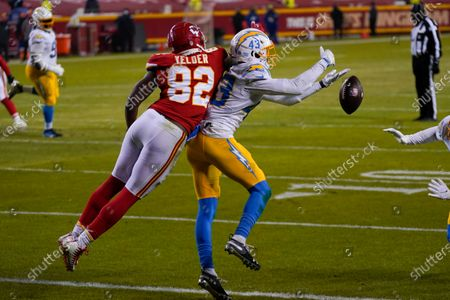Stock Image of Los Angeles Chargers cornerback Michael Davis (43) breaks up a pass intended for Kansas City Chiefs tight end Deon Yelder (82) during the second half of an NFL football game, in Kansas City