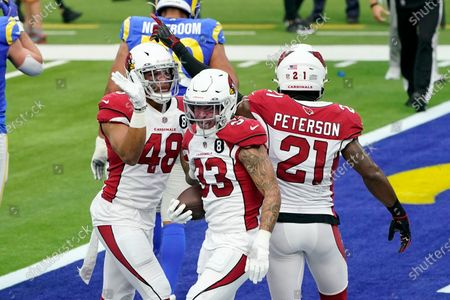 Arizona Cardinals cornerback Byron Murphy (33) celebrates his fumble recovery with linebacker Isaiah Simmons (48) and cornerback Patrick Peterson (21) during the first half of an NFL football game, in Inglewood, Calif