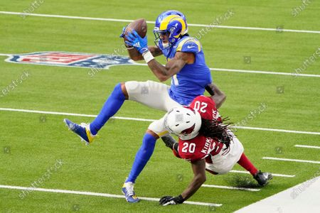 Stock Image of Los Angeles Rams wide receiver Josh Reynolds (11) catches a pass against Arizona Cardinals cornerback Dre Kirkpatrick (20) during the first half of an NFL football game in Inglewood, Calif