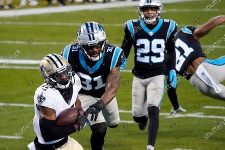 New Orleans Saints wide receiver Emmanuel Sanders scores past Carolina Panthers strong safety Juston Burris during the first half of an NFL football game, in Charlotte, N.C