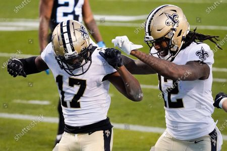 New Orleans Saints wide receiver Emmanuel Sanders celebrates after scoring with wide receiver Marquez Callaway during the first half of an NFL football game against the Carolina Panthers, in Charlotte, N.C