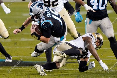 Carolina Panthers' Tommy Stevens is tackled by New Orleans Saints cornerback P.J. Williams during the second half of an NFL football game, in Charlotte, N.C