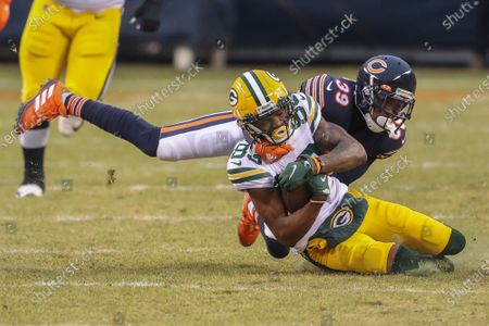 Green Bay Packers wide receiver Marquez Valdes-Scantling (83) is tackled by Chicago Bears free safety Eddie Jackson (39) during the first half of an NFL football game, in Chicago