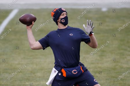 Chicago Bears quarterback Nick Foles (9) warms up before an NFL football game against the Green Bay Packers, in Chicago