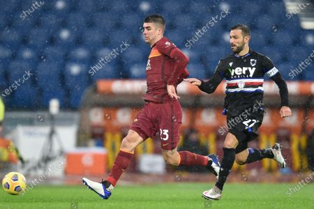 Stock Photo of ROME, ITALY - January 3 : Gialluca Mancini (L) of AS Roma in action against Fabio Quagliarella (R) of UC Sampdoria during the Serie A soccer match between AS Roma and UC Sampdoria at Stadio Olimpico on January 3,2021 in Rome Italy /LM