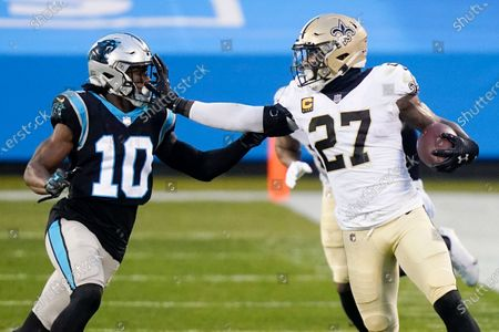 New Orleans Saints strong safety Malcolm Jenkins runs around Carolina Panthers wide receiver Curtis Samuel during the first half of an NFL football game, in Charlotte, N.C