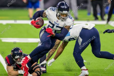 Tennessee Titans running back Derrick Henry (22) gets past Houston Texans defensive end J.J. Watt (99) while carrying the ball during the 3rd quarter of an NFL football game between the Tennessee Titans and the Houston Texans at NRG Stadium in Houston, TX. The Titans won the game 41 to 38